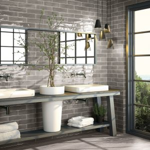 Double white sink vanity with grey domestic wall tile