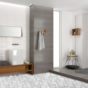 modern bathroom with white patterned floor tile and grey tile walls