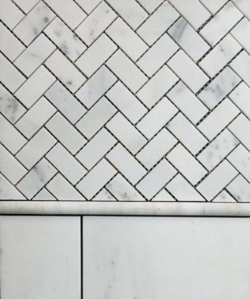 white Herringbone Mosaic 1x2 rectangular tile with black grout